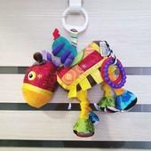 Фирменные крутезные игрушки на коляску или кроватку.