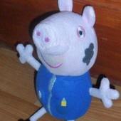 Джордж, младший брат свинки Пеппы. Хрюкает.