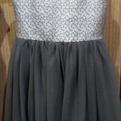 Новое платье,на подкладке и с фатиновой юбкой указан размер 11 лет, ориеньировочно по замерам