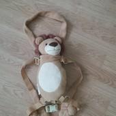 Мягкая игрушка рюкзак львенок с карманчиком.