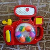 Развивающая игрушка погремушка, торохтушка, пищалка фотоаппарат