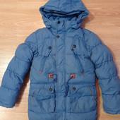 Очень теплая зимняя куртка на 10-11 лет.