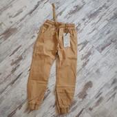 Стильные брюки Венгрия горчично коричневый р134длина 78/53см