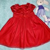 Шикарное мерцающее платьице в новом состоянии,на малышку 9-12 мес.