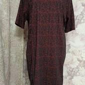 Новое с бумажной биркой.Платье из фактурной ткани с блесками,размер 22.